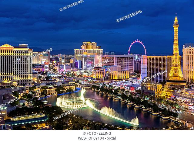 USA, Nevada, Las Vegas, Strip, fountain, hotels and Eiffel Tower at blue hour