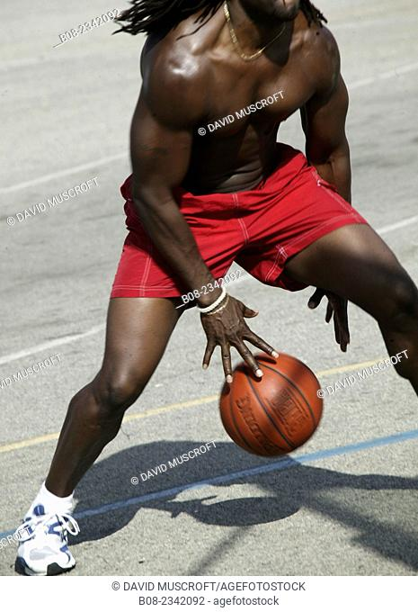 man playing basketball in a park, Venice Beach, California, USA