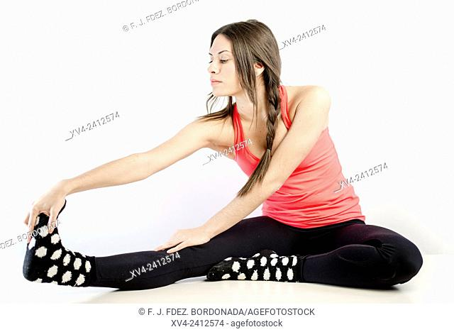 Young Woman doing Fitness in her home
