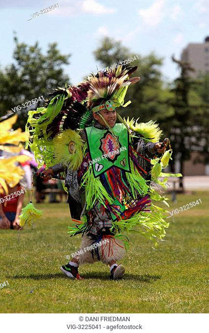 CANADA, BRAMPTON, 23.06.2012, A young Mohawk Indian brave from the Turtle Clan wearing traditional regalia competes in a fancy dancing competition at a pow-wow...