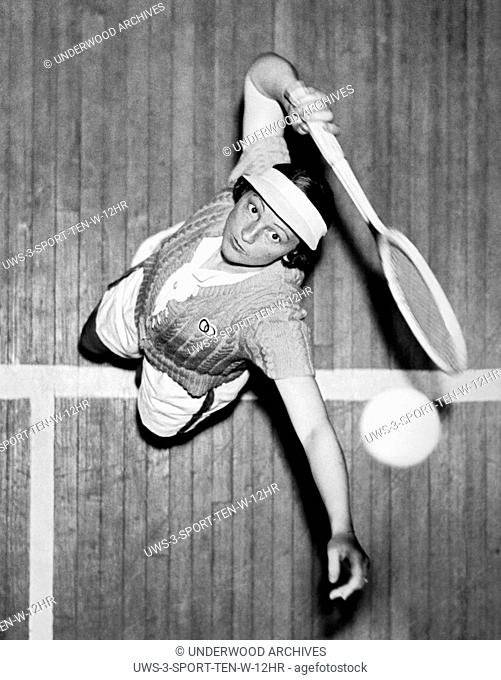 New York, January, 1937 Mme. Silvia Henrotin of France, is the new U.S. Women's Indoor Tennis Champion. Here she's seen serving from an overhead view as she won...
