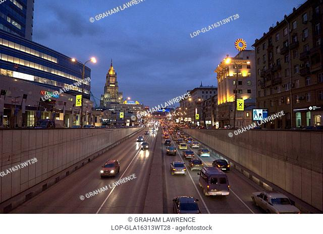 Russia, Moscow Oblast, Moscow. View of a freeway and traffic at Arbatskaya