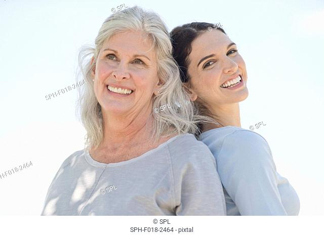 Senior woman with daughter smiling to camera, portrait