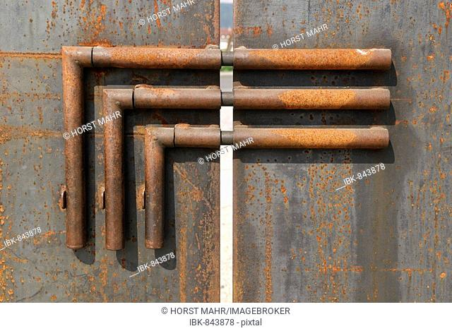 Triple bolt on a gate made of untreated steel plates