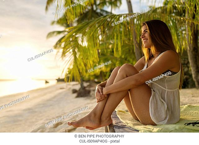 Young woman looking out from Anda beach, Bohol Province, Philippines