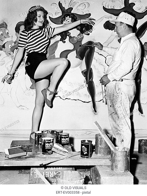 Dancing woman posing for mural painter All persons depicted are not longer living and no estate exists Supplier warranties that there will be no model release...