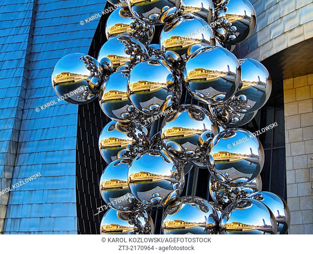 "Sculpture """"The Big Tree"""" consisting of 80 stainless steel balls with reflections by Anish Kapoor in front of The Guggenheim Museum in Bilbao, Biscay"