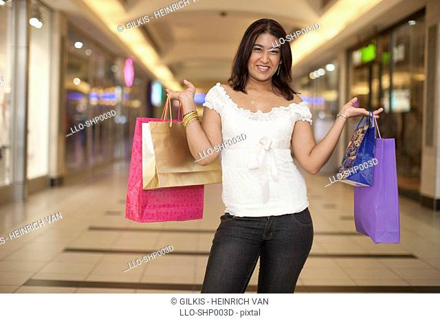 Young woman shopping in mall, KwaZulu Natal Province, South Africa