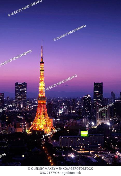 Tokyo tower at night over purple twilight sky. Minato, Tokyo, Japan