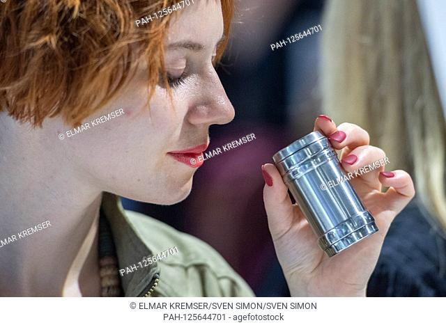 """An exhibition visitor smells a sample, """"""""death of grandmother, soon after"""""""", INVISIBLE SILENCE is a collaboration between Sissel Tolaas (not pictured) and..."""