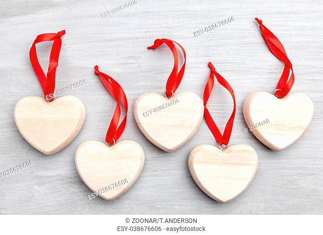 Love concept. Hearts on grey rustic background