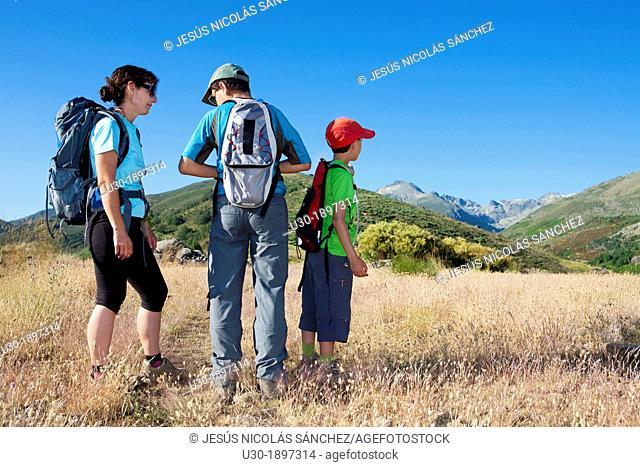 Mountaineers resting in Sierra de Gredos Regional Park, Ávila  Castilla y León  Spain