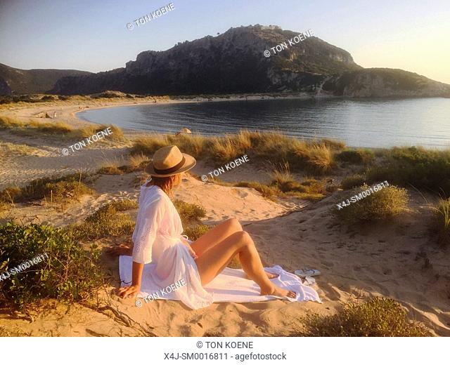 young woman enjoying the beach side in Greece (MR)