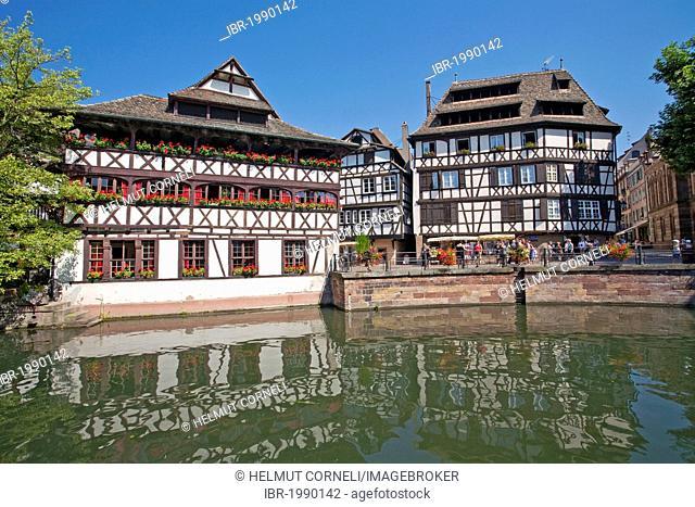 On the left Maison des Tanneurs or Gerwerstub restaurant on the Ill river, Petit France, Strasbourg, Alsace, France, Europe