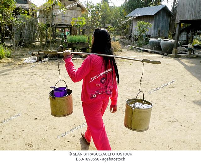 CAMBODIA. Projects of DPA in Stung Treng, supported by SCIAF. Case study with benefciaries Lek Kamlay 48 and her daughter Lom Ling 18  Kamlay has 5 children