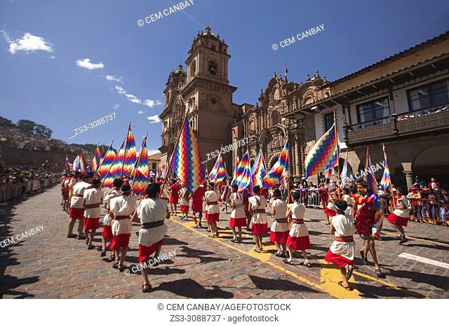 Scene from the celebrations of the Inti Raymi Festival at Plaza de Armas with the Iglesia De La Compania De Jesus-La Compania De Jesus Church at the background...