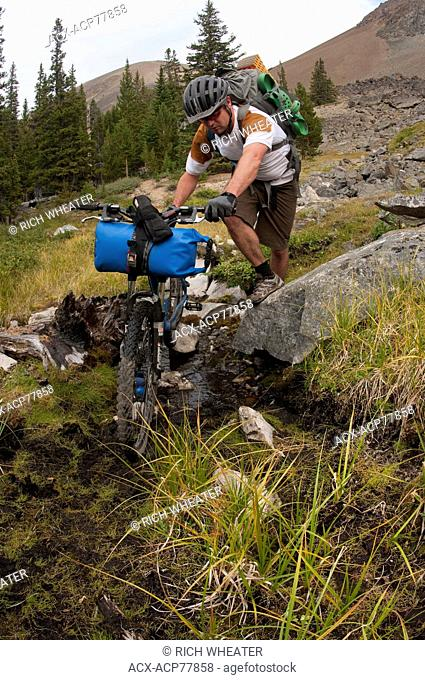 Mountain bike touring near Lorna Lake, Spruce Lake Protected Area, South Chilcotin Mountains. British Columbia, Canada
