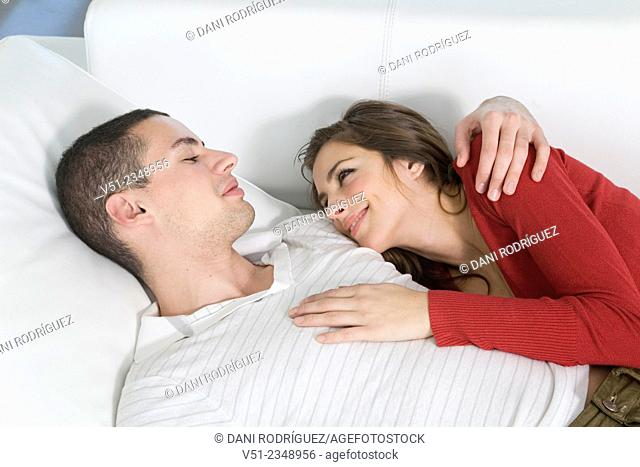 Young couple in love on the sofa