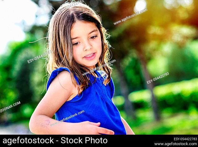 portrait of happy cute child with flower garden on background