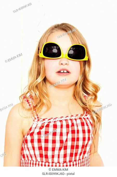 Girl with sunglasses on upside down