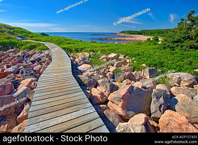 Wooden walkway along the at Green Cove Trail through the rocky shoreline along the Cabot Strait (Atlantic Ocean). Cabot Trail. Cape Breton Island