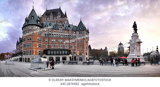 Panoramic scenery of Fairmont Le Château Frontenac at dusk with dramatic sky, luxury grand hotel Chateau Frontenac, National Historic Site of Canada