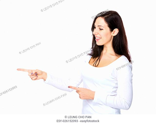 Brunette woman with two finger point aside