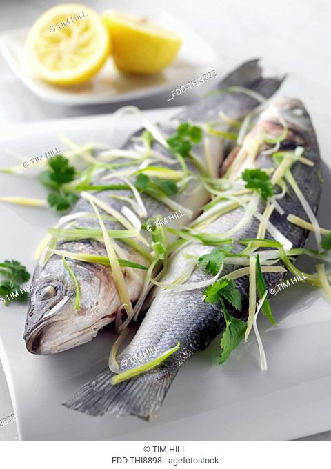 Sea bass cooked in foil with ginger and spring onions