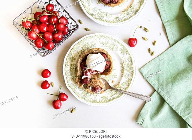 Cherry tart with whipped cardamom cream