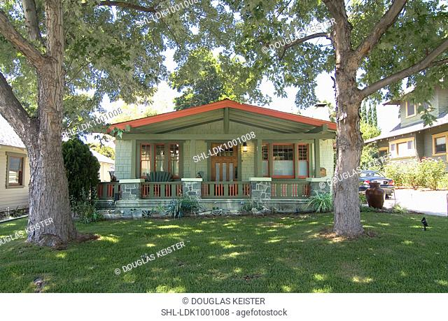 Exterior one story bungalow with red trim