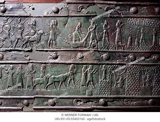 The wooden gates of Shalmaneser III with bands of relief decoration in bronze