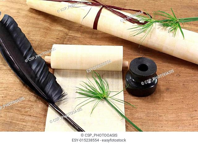 Papyrus scroll with quill
