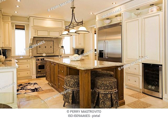Traditionally styled kitchen with tiled floor