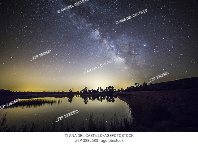 Milky way over Valbona dam in summer Teruel Aragon Spain