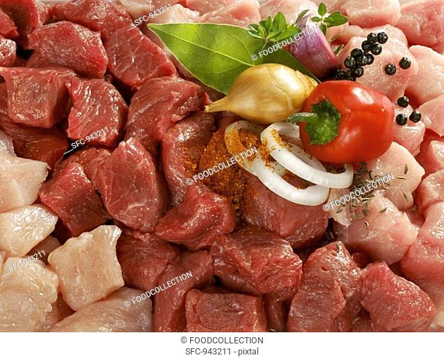 Mixed diced meat with onion, herbs and spices