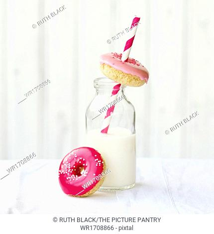 Mini donuts served with a bottle of milk