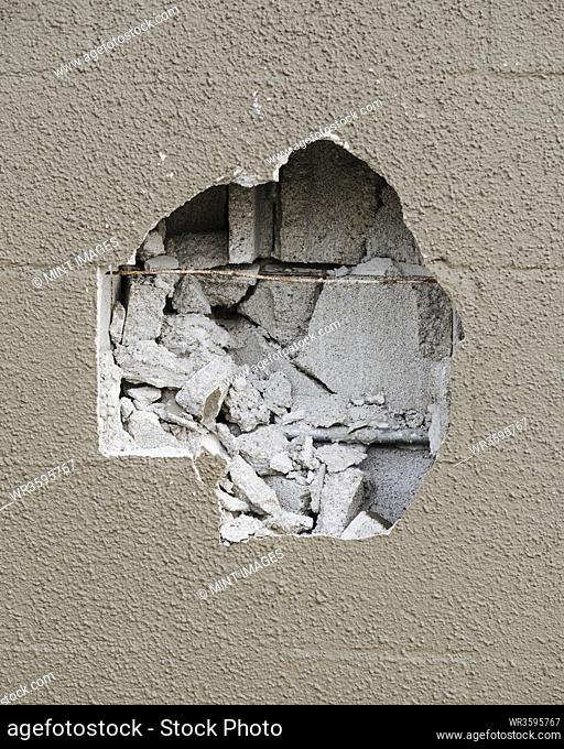 Detail of damaged concrete building wall
