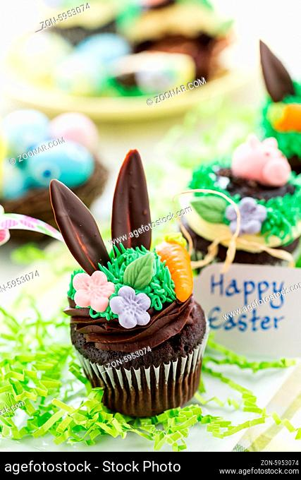 Easter chocolate cupcakes decorated with piggy and bunny ears