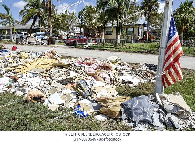 Florida, Everglades City, after Hurricane Irma, houses homes residences, storm disaster recovery cleanup, surge flood damage destruction aftermath, trash