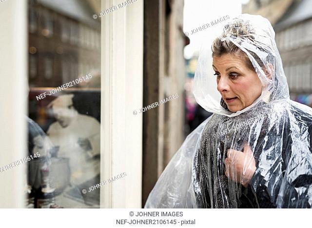 Woman wearing rain poncho