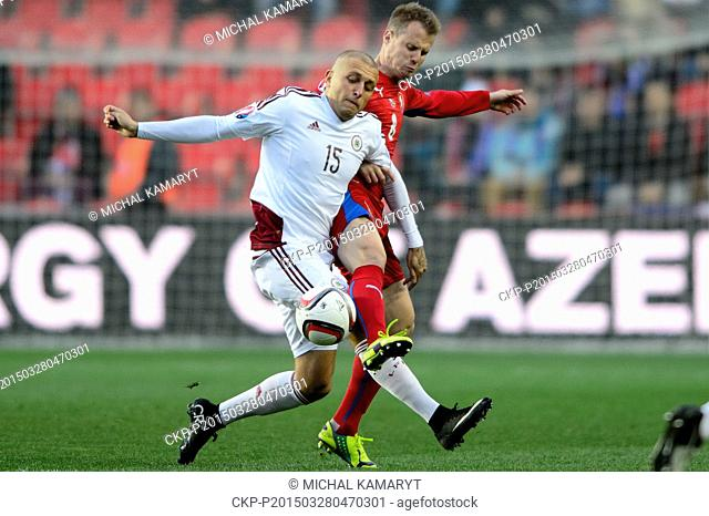 David Limbersky of Czech Republic, right, and Deniss Rakels of Latvia, fight for a ball during the Euro 2016 group A qualifying soccer match between Czech...