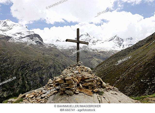 Gran Paradiso National Park between Piemonte Piedmont and Aosta valley Italy Garian Alps cross at the old path to the Val Salvarenche at the high plateau Plan...