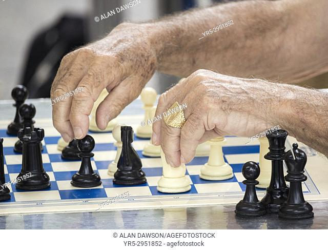 Men playing chess outdoors in Parque Santa Catalina in Las Palmas, Gran Canaria, Canary Islands, Spain