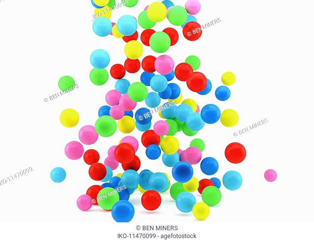 Abstract cluster of multicolored balls on white background