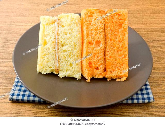 Snack and Dessert, Vanilla and Orage Chiffon Cake Made With Butter, Eggs, Sugar, Flour, Baking Powder and Flavorings on A Dish