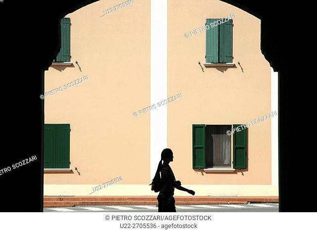 Bentivoglio (Bologna), Italy: woman walking along a street
