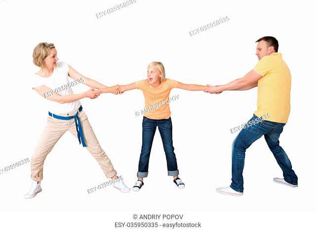 Parents Pulling Their Daughter's Hand Against White Background