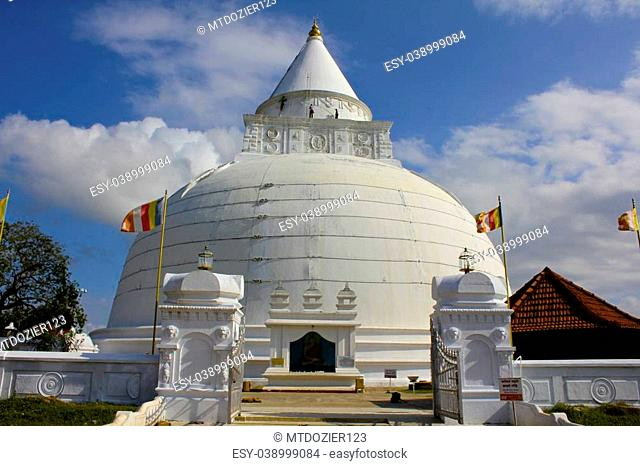 Blue sky forms a colorful background for this majestic Buddhist stupa in Tissa, Sri Lanka