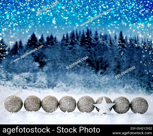 Silver star and christmas balls.Christmas decoration with snow and star isolated on forest background