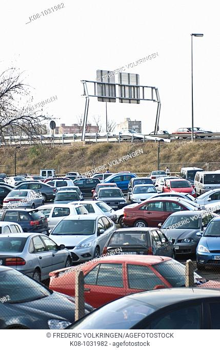 Parking lot by freeway, Spain